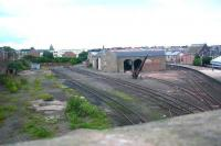 The disused goods yard and shed on the west side of Arbroath station, seen looking north from Keptie Street in August 2006. The buildings have since been demolished [see image 21325].<br><br>[John Furnevel&nbsp;09/08/2006]