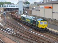 Freightliner 66595 passing through Perth station on 28 June 2015 with a Carmont - Millerhill ballast train.<br><br>[Bill Roberton&nbsp;28/06/2015]