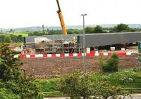 Grabshot from a passing train showing the eastern end of the new Bargeddie bridge on 29th June 2015.<br><br>[Colin McDonald&nbsp;29/06/2015]