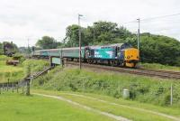 37218 leads the 2C47 Preston to Barrow service north through Bay Horse on 24th June 2015. 37402 was bringing up the rear. The two loco hauled sets mainly shuttle between Barrow and Carlisle but one makes a return trip through to Preston each weekday morning.  <br><br>[Mark Bartlett 24/06/2015]