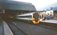 In February 1998, as the light starts to fade, a class 158 calls at the little-used Platform 3 at Perth with an Inverness to Edinburgh service. <br><br>[David Panton&nbsp;/02/1998]
