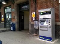 Marketing 101 - this ticket machine at Nuneaton Trent Valley used to be locked up at night, behind the black painted doors on the extreme left. Now that it is accessible after 8pm, perhaps they will sell more tickets?<br><br>[Ken Strachan 19/06/2015]