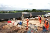 Contractors working at the construction site of the new Bargeddie bridge on 29th June 2015, seen from a passing train.  The bridge is due to be moved into position during a line closure from 11th - 26th July.<br><br>[Colin McDonald&nbsp;29/06/2015]