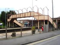 The now roofless footbridge at the north end of Yatton Station seen from the upside approach road on 10 May 2015. Note the half landings incorporated on each side of the bridge.<br><br>[David Pesterfield&nbsp;10/05/2015]