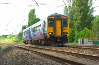 The Northern 1603 service from Blackpool North to Liverpool Lime Street approaches Bridge 90 at Euxton on 27 June 2015.<br><br>[John McIntyre&nbsp;27/06/2015]