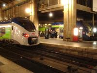 Two generations of SNCF TER EMUs, operating services to the Picardie Region, stand at Gare du Nord during the early evening on 24 February 2015. Nearest the camera is new Alstom Regiolis 6 car single deck unit 84519L, whilst across platform is older Alstom built double deck unit 446.<br><br>[David Pesterfield&nbsp;24/02/2015]