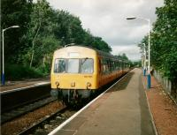 In July 1997 DMU 101691 draws into 'Shaws West with a Barrhead service. Although surviving a few years into the period of SPT carmine and cream livery none of the 101s got the treatment. Pity; I think it would have suited them.<br> <br><br>[David Panton&nbsp;17/07/1997]