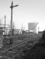 Looking east from the A955 level crossing over the Frances Colliery branch in 1983.  The Scottish Oils and Shell Mex depot in the background was served by a siding from the mid 1920s till the mid 1950s.<br><br>[Bill Roberton&nbsp;//1983]