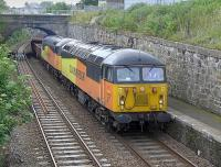 Colas 56113 and 56078 enter Kinghorn station on 4 July 2015 with a Millerhill - Inverness ballast train.<br><br>[Bill Roberton&nbsp;04/07/2015]