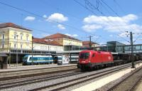 A typical scene at Regensburg in south east Bavaria on 17th June, with an international freight train - in this case hauled by an Austrian Railways (OBB) Taurus electric loco - hurrying through the centre roads at the Hauptbahnhof, while in the background a Class 223 diesel of the 'Alex' company has just been released from the stock of its Munich-Regensburg train. Alex also run the Munich-Prague trains, one of many franchised services which DB has lost to private operators in this part of Germany in recent years [with thanks to Bill Jamieson].<br><br>[David Spaven&nbsp;17/06/2015]