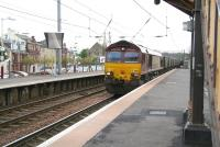 EWS 66165 brings an eastbound coal train from Hunterston Import Terminal  through platform 1 at Saltcoats station on 17 May 2007 on its way to Longannet power station.<br><br>[John Furnevel&nbsp;17/05/2007]