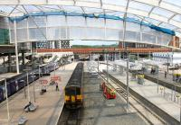 Just a little more tidying around the new Metrolink section of Manchester Victoria and the station will be ready to receive trams from the link to Exchange Square that may open later in 2015, ahead of the full <I>second city crossing</I>. 155341 leaves from the Network Rail side of Victoria on 25th June 2015, heading for Leeds via Todmorden and Dewsbury.  <br><br>[Mark Bartlett&nbsp;25/06/2015]