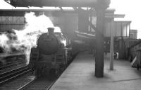 The 11.am service to Glasgow St Enoch awaiting its departure time at Carlisle platform 3 on 11 April 1964. The locomotive is Polmadie shed's Standard class 5 4-6-0 no 73076.<br><br>[K A Gray&nbsp;11/04/1964]