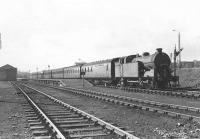 N2 0-6-2T 69565 pulls away from Clydebank East on 18 April 1957 with a train for Springburn. Clydebank East station closed in September 1959.<br><br>[G H Robin collection by courtesy of the Mitchell Library, Glasgow&nbsp;18/04/1957]