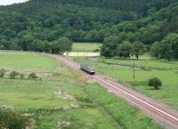 Southbound along the valley of the Gala Water between Fountainhall and Stow on 2 July 2015. The train is the 2Z52 1204 Newcraighall - Tweedbank crew training trip.<br><br>[John Furnevel&nbsp;02/07/2015]