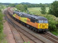 Colas 56078 and 56113 pass Inverkeithing East Junction on 5 July with a Moy - Millerhill ballast.<br><br>[Bill Roberton&nbsp;05/07/2015]