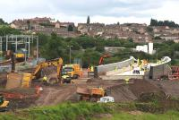 A Class 67 locomotive running light passes the Bargeddie Bridge construction site on 8th July 2015. The plant for moving the bridge to its final location is now in place below the structure itself.<br><br>[Colin McDonald&nbsp;08/07/2015]