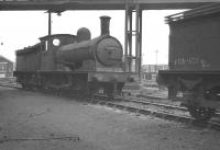 J25 0-6-0 65691, standing below the footbridge linking Darlington steam shed with the DMU depot on the west side of the main line. Thought to have been photographed in the autumn of 1961, between withdrawal from North Blyth in October and cutting up in the nearby works during November.<br><br>[K A Gray&nbsp;//1961]