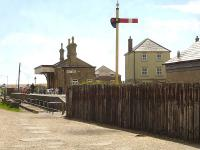 Looking seaward to the former West Bay station south of Bridport, showing the sleeper wall erected along the approach track-bed and the departure home signal that stands guard north of the station. West Bay saw its last rail passengers in September 1930.<br><br>[David Pesterfield&nbsp;12/05/2015]