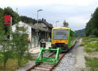 A typical scene from a German branch line today, with formerly extensive infrastructure replaced by basic fit-for-purpose provision, and loco-hauled trains replaced by single-unit modern railcars, in this case one of the widely-used Stadler Regioshuttle variants. This is the terminus of the Zwiesel-Grafenau line in the Bayerischer Wald, operated by Waldbahn (over DB Netz metals) on a one-train-working basis, seen here on 19th June.<br><br>[David Spaven&nbsp;19/06/2015]