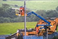 Contractors dismantling OHLE equipment on 11th July 2015, the first day of the 2 week line closure for the installation of the new viaduct.<br><br>[Colin McDonald&nbsp;11/07/2015]
