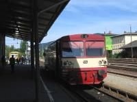 A scene which happens just twice a day at the once-busy Furth im Wald station (close to the German-Czech border). The Czech Railways 09.06 train to Pilsen ( a 1981-vintage railcar) waits for its few passengers on 25th June, while in the background a modern Oberpfalzbahn unit is soon to depart at 09.05 - normally to Schwandorf on the Regensburg-Hof main line, but on this occasion only to Roding due to track works.<br><br>[David Spaven&nbsp;25/06/2015]