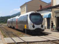 A train from Ajaccio arrives at Corte from the south on 10 July 2015. It is waiting for a southbound service to clear the single line before proceeding.<br><br>[John Thorn&nbsp;10/07/2015]