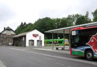 Classic German bus-rail integration at Grafenau in the Bayerischer Wald, seen here on 21st June. Ironically, the bus is operated by the Deutsche Bahn subsidiary Ostbayern Bus, while the train is operated by the private Waldbahn company.<br><br>[David Spaven&nbsp;21/06/2015]
