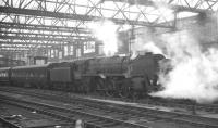 The 10.10am Edinburgh Princes Street - Birmingham New Street stands at Carlisle platform 4 on 11 April 1964. The locomotive is Britannia Pacific 70040 <I>Clive of India</I>.<br><br>[K A Gray&nbsp;11/04/1964]