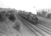 A Whitecraigs - Glasgow train leaving Williamwood on 17 August 1951. The locomotive is McIntosh ex-Caledonian 0-4-4T 55235.