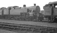 Locomotives in the shed yard at Llanelli (87F) on 7 August 1960 include Fowler 2-6-4T 42387 of Landore stabled behind home based Collett 0-6-2T 5656.<br><br>[K A Gray&nbsp;//]