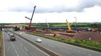 The new Bargeddie Bridge finally in position on 18th July 2015. There remain 8 days of line closure during which the track and OHLE will be reinstated. The excavation of the new M8 carriageway below the bridge spans will take place later and will not affect the railway. [See image 46140]<br><br>[Colin McDonald&nbsp;18/07/2015]