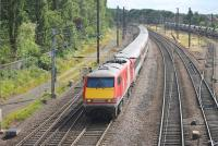 91103 leads a full Virgin liveried east coast service into York on its way from Kings Cross to Edinburgh on 18 July. The train is on the down fast line approaching Holgate Junction, seen from the Love Lane footbridge.   <br><br>[Mark Bartlett&nbsp;18/07/2015]