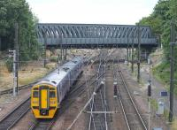 Nearing the end of a three hour journey that started at Blackpool North, a Northern service slows for York. 158757 is just about to pass under the distinctive bridge with Holgate Junction, for the station avoiding line, directly in front of the train. <br><br>[Mark Bartlett&nbsp;18/07/2015]