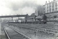 Ex-NBR class J37 0-6-0 no 64543 casts a dark cloud over Bellgrove East Junction on 16 June 1958 as it takes the former CGU route north towards Haghill Junction, skirting the tenements of Redvale Street. [See image 11305] <br><br>[G H Robin collection by courtesy of the Mitchell Library, Glasgow&nbsp;16/06/1958]