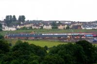 This improbable consist is actually the result of a telephoto shot of the 0624 Motherwell - Milngavie service crossing a Virgin Voyager Polmadie - Edinburgh empty stock movement on the new Bargeddie bridge on 27th July 2015, the first day of operations over the new bridge.<br><br>[Colin McDonald&nbsp;27/07/2015]