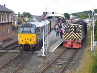 Devon & Cornwall Railways 31601 brings up the rear of a train from Manuel arriving at Bo'ness on 26 July 2015, passing D2767 in the bay platform.<br><br>[Bill Roberton&nbsp;26/07/2015]