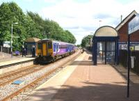Don't always believe what it says on the destination blind! View of Adlington station looking south towards Blackrod on 17 July 2015. The service is not going where the blind is displaying (Blackpool North) but towards Manchester Victoria.<br><br>[John McIntyre&nbsp;17/07/2015]