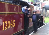 Conversation piece at Bury on 19 July 2015, prior to 13065 reversing out of the station [see image 52061].<br><br>[Ken Strachan&nbsp;19/07/2015]