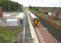 Just add passengers? Newtongrange station on 30 July 2015 looking more or less complete. Arriving at the platform is the 1058 Tweedbank - Newcraighall.<br><br>[John Furnevel&nbsp;30/07/2015]