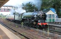 60163 <I>Tornado</I> lifts the returning <I>Torbay Express</I> through Torre station in the Torquay suburbs on its way from Kingswear to Bristol on 26th July 2015. <br><br>[Mark Bartlett&nbsp;26/07/2015]