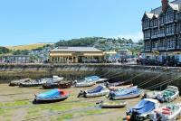 Dartmouth enjoyed all the facilities of a Great Western Railway station, except trains. Tickets could be purchased through to Paddington but the railway ferry first had to be taken across the Dart to Kingswear station. After closure in 1972 the building became the <I>Station Restaurant</I>, seen here looking across the harbour with Kingswear behind across the river. <br><br>[Mark Bartlett&nbsp;31/07/2015]