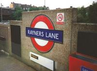 The classic LT roundel (or bullseye) seen here at Rayners Lane in July 1994. Not untypically for Metroland the station came first, in 1906, when Rayners Lane was just that - a lane. It suddenly became a suburb between the wars and mushroomed.<br> <br><br>[David Panton&nbsp;14/07/1994]
