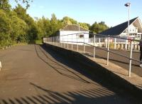 Looking south from the Loch Lomond end of the platform at Balloch Pier on 15 July 2015.  The platform and former station building both appear to have been well looked after. [See image 22314]<br><br>[Ken Strachan&nbsp;15/07/2015]