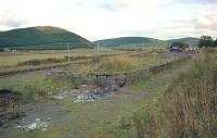 The former loading bank at Elvanfoot in 1994, with the WCML beyond the fence on the left. The station was located in the distance and the Leadhills and Wanlockhead branch joined the mainline on the left side of the loading bank.<br><br>[Ewan Crawford&nbsp;//1994]