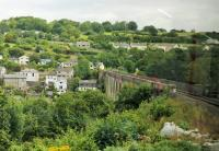 View of the famous Calstock viaduct from the left hand window of a Gunnislake bound Sprinter cautiously rounding the approach curve on the Devon side. The Tamar river is the county boundary and Calstock village in Cornwall can be seen on the far side of the bridge.<br><br>[Mark Bartlett&nbsp;29/07/2015]