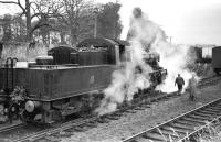 Scene at Lauder on Saturday 15 November 1958, featuring St Margarets BR Standard Class 2 2-6-0 no 78049, a mere 3 years old at that time. The locomotive had arrived with the BLS <I>'Last train to Lauder'</I> from Fountainhall.  Lauder station closed to scheduled passenger services in 1932, although freight continued over the line for many years, not least serving a large WW2 Ministry of Food buffer depot built alongside Lauder station [see image 27003]. <br><br>[D Welsh Collection [Courtesy Bruce McCartney]&nbsp;15/11/1958]