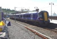 ScotRail 380017 awaits its departure from Wemyss Bay in the midday sunshine on 7 August 2015.<br><br>[John Steven&nbsp;07/08/2015]