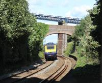 A FGW Plymouth to Paddington HST hurries through Teignmouth and onto the coastal line to Dawlish and Exeter. The further of the two over bridges seen here features in many lineside photographs at Teignmouth but usually from the sea wall [See image 43852] <br><br>[Mark Bartlett&nbsp;29/07/2015]