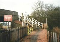 The rather homely stairs to the Up platform at Rosyth in April 1999. I imagine that post once held a notice about having your ticket ready for inspection. Arrangements here are now a little more disabled-friendly.<br><br>[David Panton&nbsp;02/04/1999]